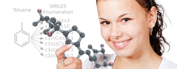 Girl smiling and holding molecule